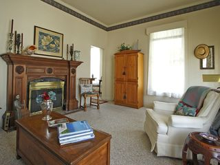 Pacific Grove cottage photo - Comfortable cozy living room with gas log fireplace, original mantel