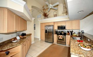 Vacation Homes in Marco Island house photo - Coastal Kitchen w Custom Cabinetry and Granite ...