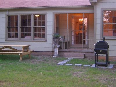 BBQ charcoal grill, large backyard with privacy fence. Plenty of room for kids.