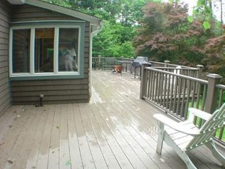 Sharon house photo - The deck in the rain (the lawn furniture was put away)