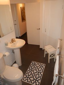 Immaculate bathroom with in-floor heat and bountiful linens