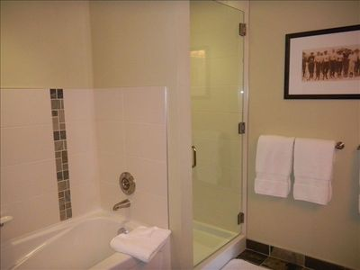 Two large bathrooms with tub and shower