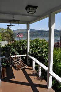 Porch swing and the river view (bushes has been trimmed for a better view)