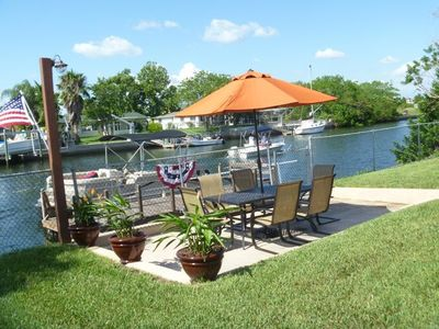 Sit in the sun and have coffee or dine while watching the boats pass