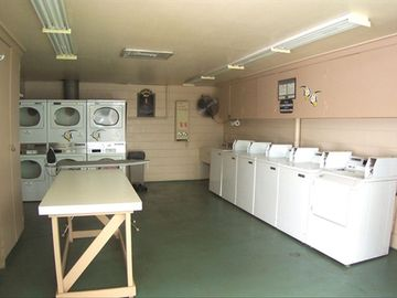 Coin-op laundry facility. Iron & ironing board available; small library of books