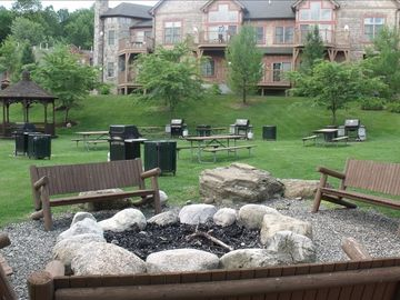 Main area behind the unit, fire pit, grills, picnic tables