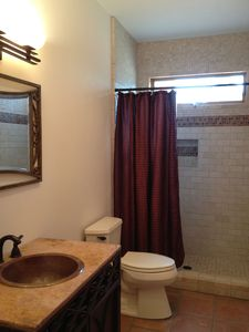 3rd bathroom with stone tile shower