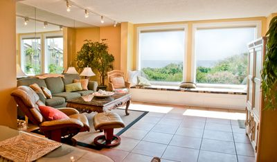 The living room window seat overlooks the ocean - perfect for reading!