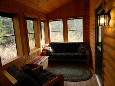 Screened porch has futon for outdoor sleeping