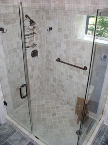 Tumbled marble shower with glass surround