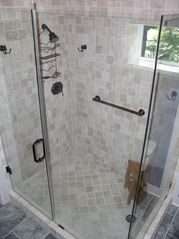 Savannah cottage photo - Tumbled marble shower with glass surround