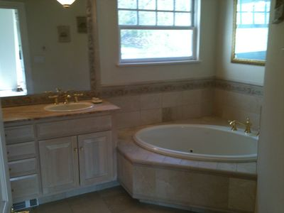 Master Bath marble & tile finished w/ whirlpool tub, 2 sinks & shower stall