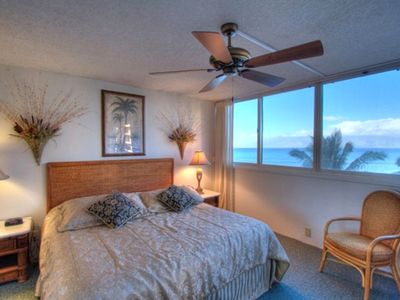 elegant master bedroom with picture window looking off to ocean