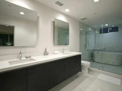 Master BR en-suite.  Walk-in wet room with two shower heads and tub.
