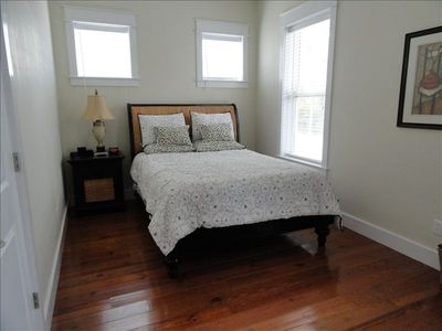 1st floor bedroom with queen bed; adjacent full bath