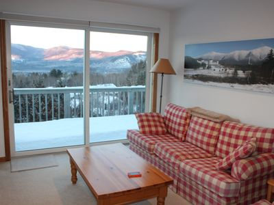 Intervale condo rental - Living room with our photo of Mt. Washington and the Presidentials