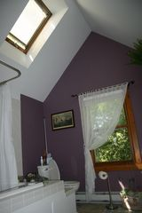 Lake Sinissippi cottage photo - Upstairs: Full bathroom w spa bathtub, high ceiling with skylight, orchard view.