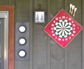 Paradox Lake house photo - There is a dart board, pool table, fossball table and a ping pong table.