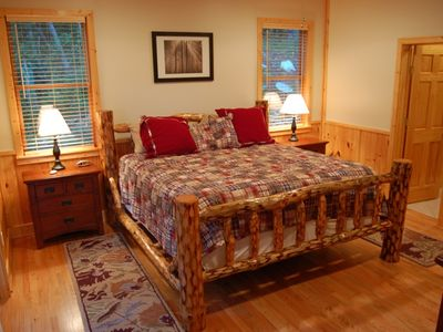 The master bedroom, with sliding door to the deck, Jacuzzi tub, and 40-inch TV.