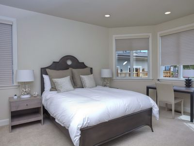 Downstairs bedroom with queen bed and desk