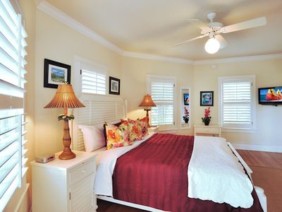 The 3rd master bedroom: the Turret Room with a king bed, flat screen TV.