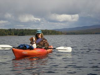 Milan cabin photo - Britney and Tracy Kayaking at South Pond just 3 miles away