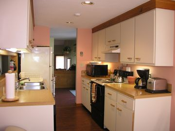 Galley kitchen with all the amenities and seating for 4 people.