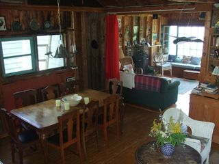 Baddeck house photo - View of Dining Room into Lakeside Den with Fireplace