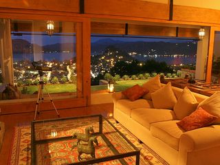Valle de Bravo villa photo - Living room has a wall of glass looking out onto the town and lake
