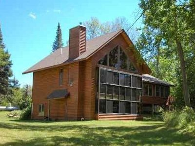 Aitkin cabin rental - View of cabin from lake side- Three stories of lake view!