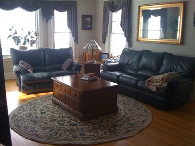 Leather reclining sofa and love seat