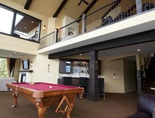 games room- pool table, darts, wet bar, media area, views, elevator