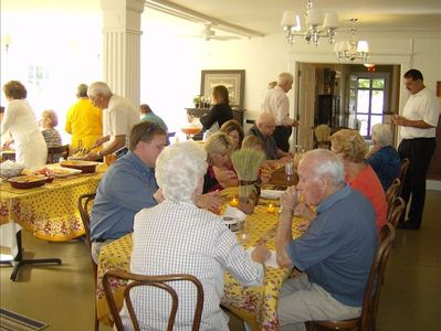 Asheville lodge rental - Guests enjoying a meal in the dining room that sits up to 40