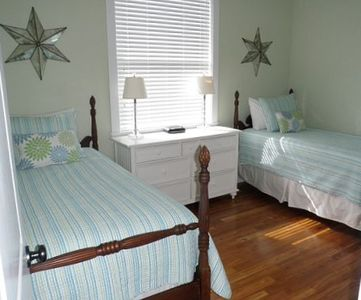 Extra guest room with antique poster beds ~ and great views of the ocean