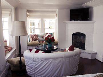 Master Bedroom Sitting area complete with a cozy fireplace and comfy pillows.