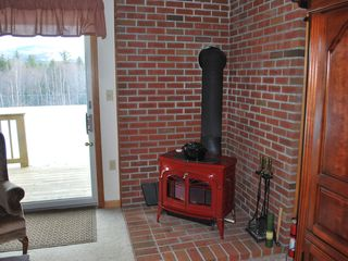 North Conway condo photo - Wood stove and boy does it crank out the heat
