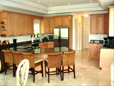 Nice large kitchen with island for extra seating - kitchen has views to lake