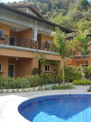 Playa Herradura condo photo - The condo overlooks a lushly landscaped free-form swimming pool and hot tub.