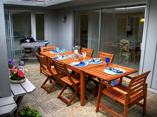 Pacific Grove house photo - Protected outdoor dining with BBQ
