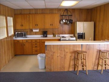 Full Kitchen with stove, oven, microwave, dishwasher, and coffee pot.