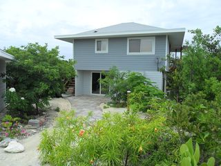 Staniel Cay cottage photo - Entering from the paved road and showing the stairs to the cottage above.