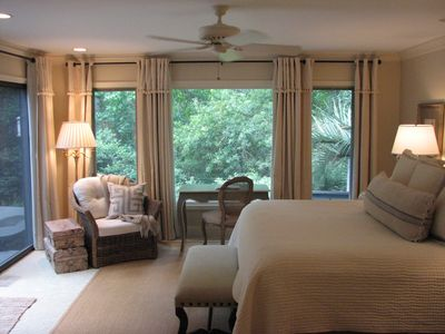 custom window treatments with blackout curtains - wall of windows in master