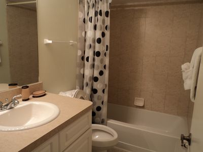 Just renovated guest bathroom with tub.