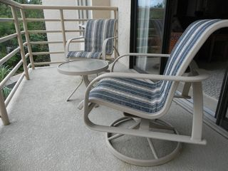 Palmetto Dunes condo photo - Balcony #2 has rocking chairs and small table.