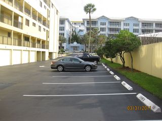 Deerfield Beach condo photo - View of West parking area at the back and private stall No. 12