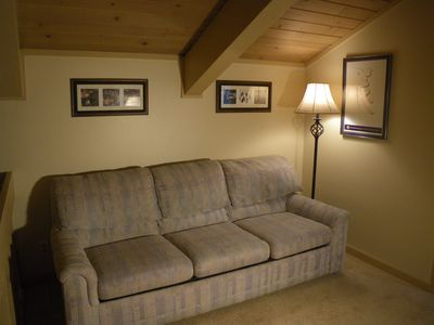 Sofa sleeper in loft will accommodate additional guests.