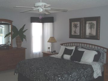 Master bedroom suite- King size bed with balcony doors to upper patio