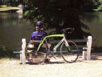 Cyclist relaxing by river