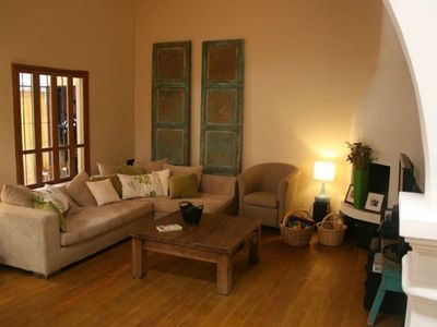 Living room area with TV, DVD and a large selection of movies. Wireless Internet