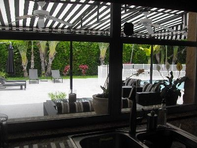 view of patio and pool from kitchen